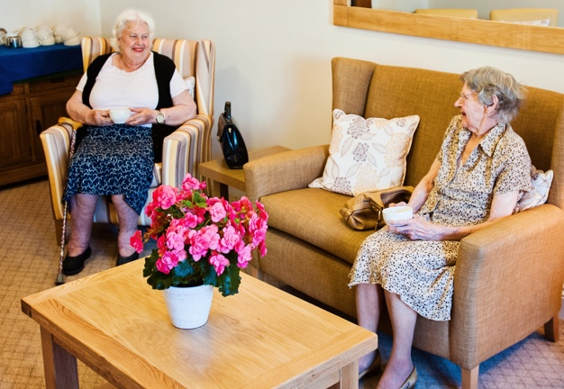 two retired ladies having tea at care home
